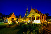 Sunrise scence of Wat Phra Singh temple. This temple contains supreme examples of Lanna art in the old city center of Chiang Mai,Thailand. (MongkolChuewong) Tags: ancient antique architecture art asia asian background beautiful bright buddha buddhism buddhist center chiang chiangmai craftsmanship culture design detail dusk exterior faithstable fine gold king landmark lanna lighting lucktime mai outdoors peace phra plaza popular pray prayer religion scene sculpture singh skyholy statue temple thai thailand travel twilight unity unseen worship