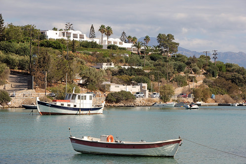View over the bay to the peninsula with the Minos Palace resort