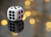 "^ (MargoLuc) Tags: macromondays ""member'schoicegamesorgamepieces theme dice dado bokeh reflection golden black red white game giocodelloca"