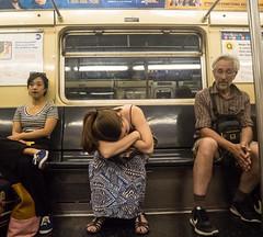 Another Subway Sleeper (UrbanphotoZ) Tags: man women subway sleeping nocellphones qtrain woman headdown ponytail print printdress indifference mta notfeelingwell stayawayfromtheplatformedge airconditionedcar manhattan newyorkcity newyork nyc ny
