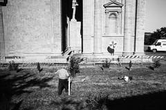 Man preparing for the festa at San Biagio. Leica M6, 35mm Summciron ASPH, Fomopan 100 (nickdemarco) Tags: rangefinderchronicles blackwhite film leicam6classic 35mmsummicronasph italy fomopan tuscany