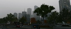 City skyline (Brandon ProjectZ) Tags: watchdogs chicago windy overcast rain roads city buildings trees natural lighting