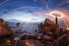 Fire spin_Ca Na beach_Blue hour_DSC_7275-1 (PRADEEP RAJA K- https://www.pradeeprajaphotos.com/) Tags: travel landscape nature light sky blue rock seascape water places vietnam beach slowspeed