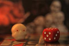 """Games or Game Pieces"" (eleni m) Tags: macromondays gamesorgamepieces macro indoor game hauntedcastle hmm dice mini 12cm ghost memberschoice candlelight"