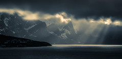 Light of hope (Sizun Eye) Tags: reine lofoten norway hope light sea fjord isle mountains snow clouds sunbeam sunlight reflections darkness rays sunrays sky sizuneye nikond750 tamron2470mmf28 leefilters