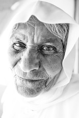The face of a kurdish angel (Giulio Magnifico) Tags: mosul curiosity civilwar leica iraq woman kurdistan macro portait soulful thoughts turkey naturallight typical detail streetphotography vintage camp old muslim desert kurdish iraqturchia middleeast thought backlight power future leicaq blackandwhite streetlife micro ancient detailing veil happy bw happiness kind 28mm isis yazidi traditional