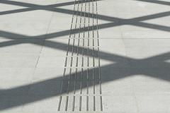 Stripes en shadows (Jan van der Wolf) Tags: map161254v shadow shadowplay shadows schaduwspel schaduwen stripes strepen abstract architecture station denhaag monochrome looplijnen guidelines blind geleidelijnen