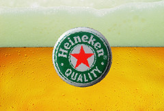 How refreshing! How Hei.....! (HansHolt) Tags: refreshing heineken beer bier cap dop red rood green groen foam schuim bubbles bellen round rond circle cirkel olympusmju9010 olympusstylus9010