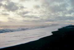 at peace, at last (xelia mj) Tags: iceland vik midral beach black sand golden circle tour winter december dec christmas 2015 ocean wave waves spray arch stack stump land island headland bay film raw photography photo photograph photographer photos landscape seascape dusk sun light clouds bright dark shadow constrast person fujifilm kodak developed develop pentax me super 1970s vintage 70s hoya lens superia xtra extra eu europe travel wanderlust aesthetic