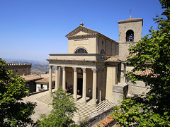 Basilica of St Marino with a portico of Corinthian columns (B℮n) Tags: monumento bartolomeo borghesi universityoftherepublicofsanmarino adriatic sea sanmarino cittàdisanmarino montetitano is land clifftop castlesis enigmatic mysteryis vertiginous views castle slopes mountain republic tourist vacation hills ridge viewpoint clifftops unesco panorama state visiting summer steep trees church palazzopublicco monte titano castellodellaguaita medieval stone wall rooftops basilicadisanmarino basilicadelsanto portico corinthian columns 50faves topf50