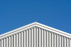 Grey building (Jan van der Wolf) Tags: map169190v minimalism minimalistic minimalisme minimal minimlistic roof dak lines lijnen simple simpel silver grey grijs building gebouw geometric geometry geometrisch triangle driehoek gevel facade symmetric symmetry symmetrie