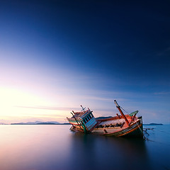 Thai fishing boat in the sea (pattana92392) Tags: blackwhite fineart photography one minimal thailand beach blue boat cloud design fisherman fishing landscape ocean old sea sky style transport transportation vacation water wooden longexposure sunset