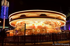 Beautiful fast light at night. (The friendly photographer.) Tags: britain candid city colour citycentre d7100 dark england flickrcom flickr funfair fun fantasticphoto fantastic fairground fairgroundrides amusement amusements google googleimages gb greatbritain greatphotographers greatphoto image images interesting carousel mamfphotography mamf nikon nikond7100 northernengland north photography photo pretoebranco photographer photograph town uk unitedkingdom urban upnorth westyorkshire yorkshire excellentphoto brilliant