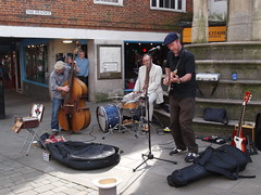 Red Jackson. (catrionatv) Tags: winchester highstreet buttercross buskers instruments guitar cello drums streetperfomers performance