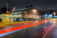 Day 325: Unionville in the rain (Antonio Cangiano) Tags: markham ontario canada ca day325 365 365project project365 redditphotoproject picoftheday okanaganphotographer toronto lights unionville mill lamplights lighttrails cartrails architecture nightshot nightphoto nightphotography longexposure night canon canoneos building road rain canonphotographer