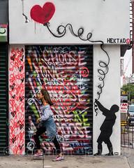 Security Gate Mural, Lower East Side, Manhattan, New York City (jag9889) Tags: 2017 20170617 gate graffiti les lowereastside lowermanhattan manhattan mural ny nyc newyork newyorkcity outdoor painting rolldown securitygate shop store streetart tagging usa unitedstates unitedstatesofamerica woman jag9889