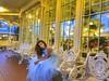 Waiting in style! (PointOfUPhotography) Tags: happywindowwednesday windowwednesday sunset bluedress girl waiting benches windows lighting yellow blue