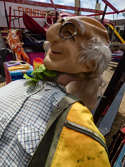 He is Part of the Furniture (Steve Taylor (Photography)) Tags: partofthefurniture mannequin dummy mask sunglasses sunnies old bald balding furniture shirt coat greyhair slide art yellow man uk gb england greatbritain unitedkingdom margate fairground pensioner