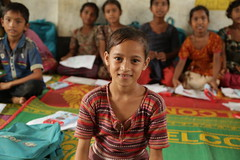 A young Rohingya refugee girl in a UNICEF temporary learning centre supported by UK aid, in Kutapalong, Cox's Bazar, Bangladesh