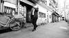 Salaryman. (Eric Flexyourhead) Tags: umeda 梅田 kitaku 北区 osaka osakashi 大阪市 kansai 関西地方 japan 日本 city urban street streetscape streetphotography japanese man salaryman walking pedestrian candid blackwhite bw monochrome 169 olympusem5 panasoniclumix714mmf40