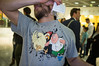 Daniele (colour) (Gary Kinsman) Tags: europeanbankforreconstructionanddevelopment exchangesquare ec2 ebrd cityoflondon broadgate fujifilmfinepixx100 exhibition vincenzoalbano faceless tshirt familyguy giantchicken fight peter fujix100 2013 people person