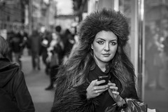 The Faux-Fur Trade (Leanne Boulton) Tags: portrait people urban street candid portraiture streetphotography candidstreetphotography candidportrait streetportrait streetlife eyecontact candideyecontact woman female girl face expression eyes look emotion mood atmosphere hat coat fur brunette hair fashion style tone texture detail depthoffield bokeh naturallight outdoor light shade shadow city scene human life living humanity society culture canon canon5d 5dmarkiii 70mm ef2470mmf28liiusm black white blackwhite bw mono blackandwhite monochrome glasgow scotland uk