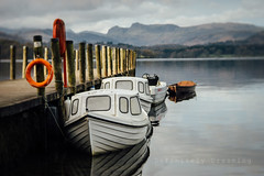 By The Lake (DefinitelyDreaming) Tags: lensbaby velvet85 lakedistrict water lakeside jetty boats