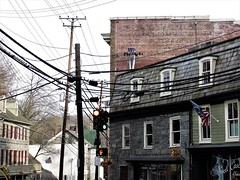 Telegraph Tuesday, Ellicott City, Howard County, Maryland (A CASUAL PHOTGRAPHER) Tags: ellicottcity howardcounty maryland utilitypoles telephonewires utilitylines historictowns telegraphtuesday stonebuildings stores signs architecture cameras canon bridgecameras canonpowershotsx60hs