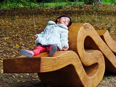"Artful Autumn At Kew Gardens @ 28 October 2017 - Wooden Seating Sculpture (Kam Hong Leung 06) Tags: ""beatriceleung"" kam ""kamhongleung"" ""leungkamhong"" 'artfulautumn' kew ""kewgardens"" ""royalbotanicgarden"" london richmond garden ""palmhouse"" 'princessofwalesconservatory' tree arboretum sculpture art autumn waterlily flower 'commonlime' 'woodlandhouse' fungi painting peacock treeling 'taichi' halloween 'rebeccalouiselaw' 'lifeindeath' 'willowsculpture' 'austrianpine' 'henrymoore' 'redoaktree' lotus 'nelumboshiroman' 'victoriaamazonica' 'xanthorrhoeajohnsonii' cactus cleistopsis sunset 'nigelross' 'woodyfoxwillow' 'claudiawegner' girl elf 'fairytale' fantasy"