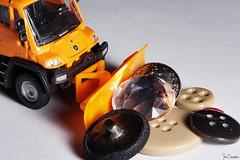 Pushing My Buttons (iecharleton) Tags: macromondays buttonsandbows buttons truck snowplow plow mercedes whitebackground macro vehicle unimog