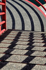 LOVE THE LINES!   NEAT LINES, CURVES AND SHADOWS,   A VERY HIGH TOWER WITH MANY PLATFORMS FOR  MILES OF WONDERFUL VIEWING.  (AND PHOTOS!)   LONDSDALE QUAY,  NORTH VANCOUVER,  BC. (vermillion$baby) Tags: londsdalequay northvancouver black curve dynamic light line pattern red repetition shade shadow stair swirl tower view art design repeat bridge bright vancouver bc vanishingpoints vanishingpoint