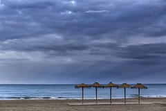 Solitude..... (Martika64) Tags: playa beach cielo sky nubes clouds mar sea tormenta storm sombrillas umbrellas quitasoles sunshades color azul blue imagenacolor colorimage espacioabierto outdoor nadie noperson mediterráneo peñiscola paisaje landscape paisajemarino seascape