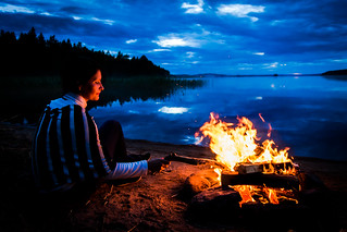 by campfire on a summer night in Lakeland Finland