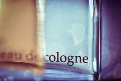 Eau de Cologne. (Neal.) Tags: macromondays eaudecologne scent aramis macro bottle glass smell stonerhymingzone contrast