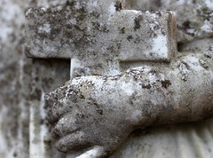 In The Arms Of The Angels (Sarah_ES) Tags: macromondays stonerhymingzone gravestone cemetary angel cross crucifix fingers hand