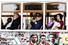 faces of Lisbon (ignacy50.pl) Tags: people faces windows tram advertising tourist sightseeing citylife reportage lisbon portugal colorful daytime streetphotography
