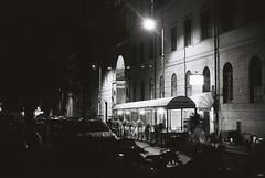 Ristorante Aurora (goodfella2459) Tags: nikon f4 af nikkor 50mm f14d lens ilford delta 400 35mm blackandwhite film analog ristorante aurora rome city roma italy night streets building lights