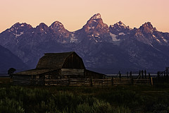Dawn on the Grand Teton (_aurora_photo_) Tags: firstrays first rays sunlight grandteton grand teton mountainrange mountain range hazy cloudless morning barn foreground interest tamoultonbarn antelopeflatsroad jacksonhole wyoming grandtetonnationalpark national park yellowstonenationalpark yellowstone
