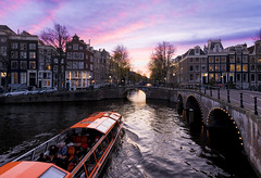 Amsterdam Skys (JH Images.co.uk) Tags: amsterdam sunset clouds boat canal water houses holland river hdr dri tourists arches