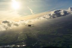 Biplane between the clouds (Tobiasstift) Tags: bücker131 jungmann flickr wolken fliegen flugzeug flight flug flying fliegerei biplane clouds cloud