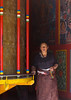 Tibetan woman turning prayer wheels in a Rongwo monastery, Tongren County, Longwu, China (Eric Lafforgue) Tags: 4044years amdo asia asian buddhism china china17222 colourimage day huangnan inarow indoors khor largegroupofobjects longwu lookingatcamera maniwheel monastery oneadultonly onepersononly onewomanonly pilgrim pilgrimage placeofworship pray prayerwheel qinghaiprovince religion religious religioussymbol ronggonchen rongpo rongwo spirituality symbolsofpeace temple tibet tibetan tibetanautonomousprefecture tongren traditionalclothing tranquility typical vertical women worldtravel tongrencounty chn