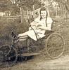 1930s Polio Girl and invalid carraige (jackcast2015) Tags: handicapped disabledwoman crippledwoman wheelchair paralysed poliogirl legbraces calipers polio invalidcarraige