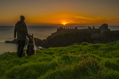 _JMK0178 (jimmckay77) Tags: dunnottar dunnottarcastle castle cliffs sunrise clifftop dawn morning mananddog sun observers watchers
