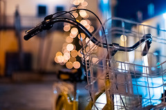 the bike in front of a christmas tree (thethomsn) Tags: basket bicycle bike bokeh christmas city dof handlebar ikea night street thethomsn transport transportation vehicle availablelight blue yellow