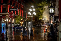 Waterproof (Christie : Colour & Light Collection) Tags: gastown reflections photography nightphotography waterproof rain weather damp wet rainy historic water worldfirststeamclock steamclock raymondsaunders vancouverlandmark bc canada afterdark historiccore cobblestone evening dark love family umbrealla cityofvancouver lights light photographer