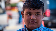 2017 - Mexico - Tequila - Sweet Treats Vendor (Ted's photos - Returns Late November) Tags: 2017 cropped mexico nikon nikond750 nikonfx tedmcgrath tedsphotos tedsphotosmexico tequila vignetting boy lad male curlyhair portrait face head tequilajalisco tequilapuebomágico tequilatour santiagodetequila bokeh nose ears shirt shirtcollar eyes reflection