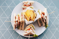 Top view of delicious sandwiches and chips (wuestenigel) Tags: fast dill breakfast sandwiches bread snack food ham french health isolated horizontal white vegetable pickles tomato lettuce club potato toast plate meat closeup chicken fresh tasty photograph platter chips meal buffet healthy lunch crisps green nobody yellow cheese sandwich