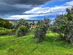 Dark clouds come to hide the sun_IMG_0430n (AchillWandering) Tags: greece lake littleprespa church island achillios florina clouds nature ciel blue village naturephotography water