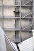 The secret meeting (BL : : photos) Tags: canoneos5dmarkii canonef70200mmf4lusm nantes iledenantes urban city concrete metal modern people france grey stairs symmetry