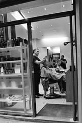 Chop Chop (Douguerreotype) Tags: candid monochrome england london blackandwhite people shop 4 british street uk mono window city britain urban gb bw store door
